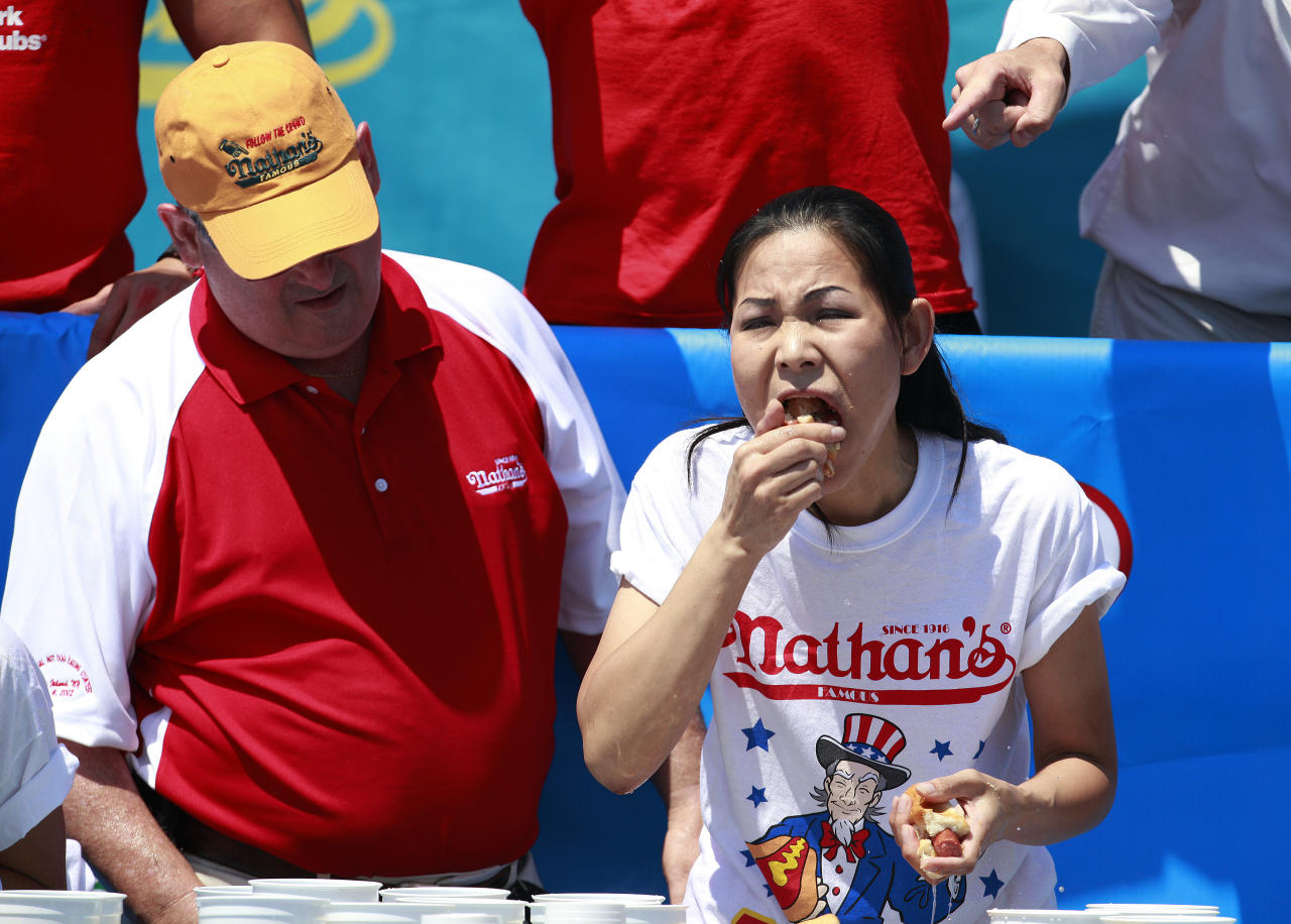 Sonya Thomas competes in the 2012 Nathan's Famous Fourth of July International Eating Contest at Coney Island in the Brooklyn borough of New York July 4, 2012. Thomas broke her record by eating 45 hot dogs to take the crown. REUTERS/Eric Thayer