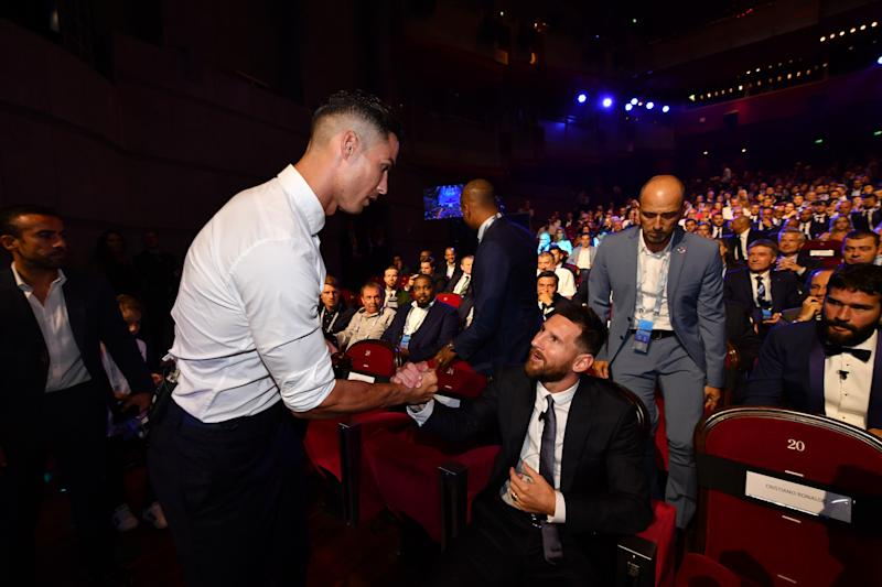 MONACO, MONACO - AUGUST 29: Cristiano Ronaldo of Juventus greets Lionel Messi of Barcelona during the UEFA Champions League Draw, part of the UEFA European Club Football Season Kick-Off 2019/2020 at Salle des Princes, Grimaldi Forum on August 29, 2019 in Monaco, Monaco. (Photo by Valerio Pennicino - UEFA/UEFA via Getty Images)