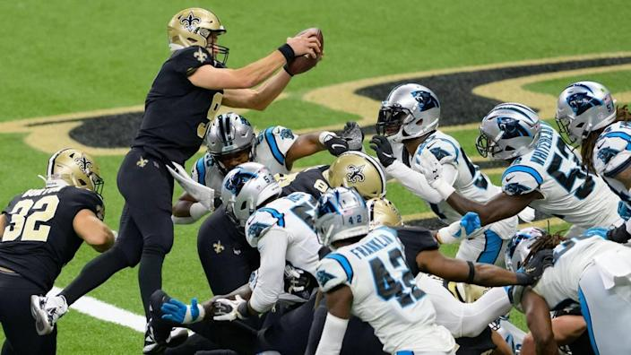 New Orleans Saints quarterback Drew Brees (9) scores against the Carolina Panthers last October. Although Brees is retired, the Saints still whipped Green Bay, 38-3, in their season opener.