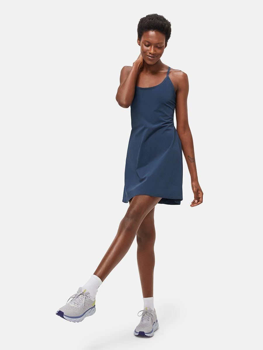 <p>The navy <span>Outdoor Voices The Exercise Dress</span> ($100) is a great neutral, and the pockets make it so useful.</p>