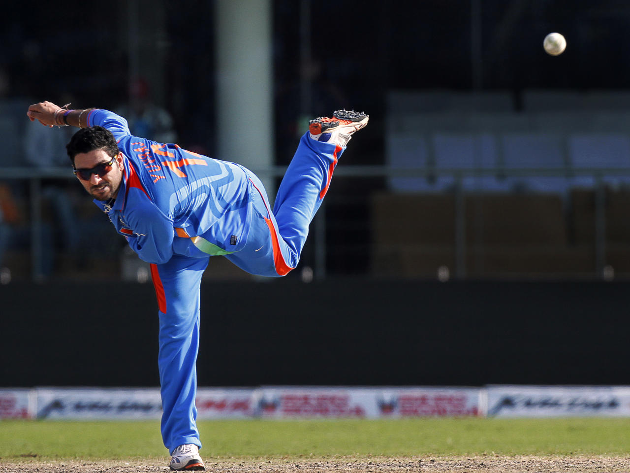 Indian Yuvraj Singh bowls during the Group B Cricket World Cup match between India and Netherlands in New Delhi, India, Wednesday, March 9, 2011.