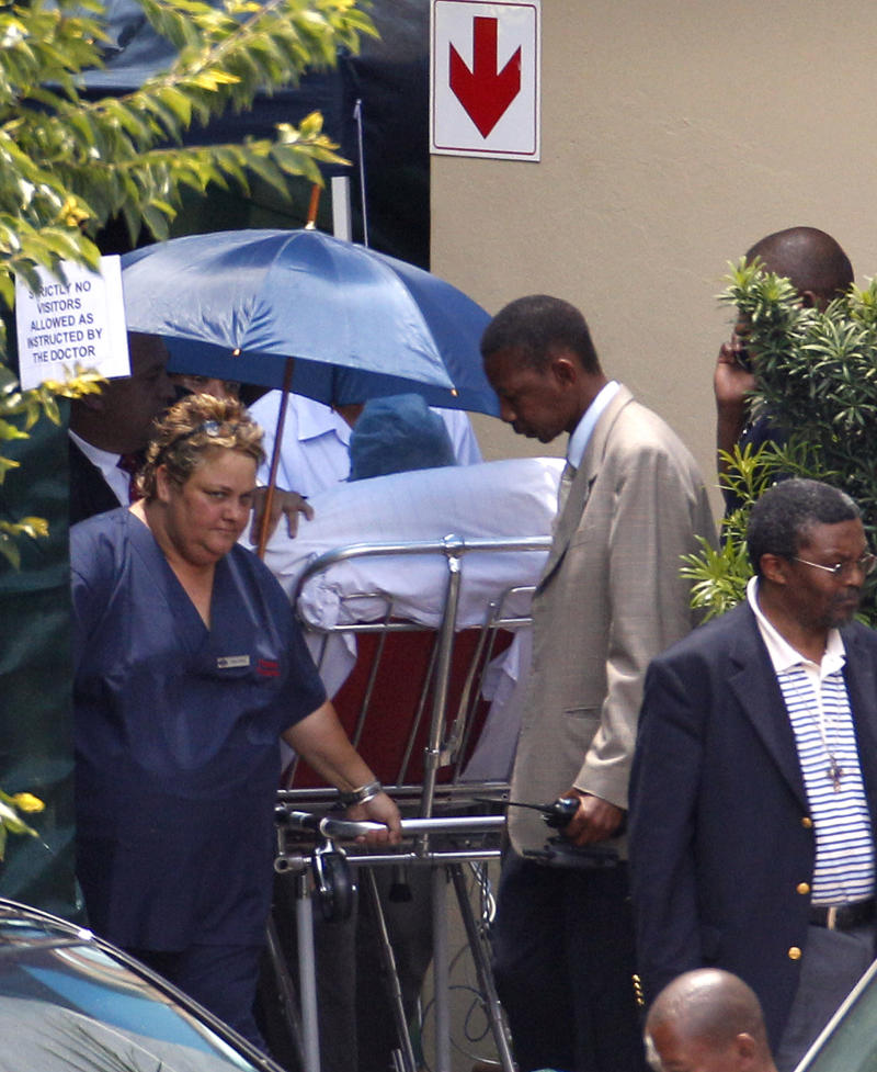 Former South African President Nelson Mandela, leaves the the Milpark Hospital in Johannesburg, South Africa, Friday, Jan. 28, 2011. Mandela was discharged from the hospital Friday after suffering an acute respiratory infection that has responded well to treatment, officials said. Surgeon-General Vejaynand Ramlakan told reporters that after three days in Johannesburg's Milpark Hospital, the 92-year-old anti-apartheid icon would now receive home-based care. (AP Photo/Themba Hadebe)