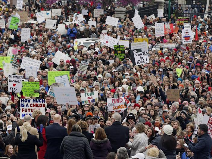 The crowd cheers during a teacher rally at the state Capitol in Oklahoma City on 2 April 2018. Teachers were holding separate protests in Oklahoma and Kentucky on Monday to voice dissatisfaction with issues like pay and pensions: AP Photo/Sue Ogrocki