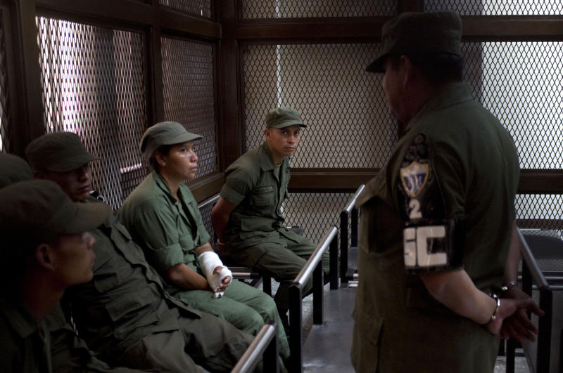 In this Oct. 11, 2012 photo, detained soldiers waits to testify at their court hearing related to the killing of Indian protesters in Guatemala City. Nine soldiers were arrested in connection with the Oct. 4, 2012 killings of Indians from the town of Totonicapan who were protesting high electricity prices on the highway. Experts said the recent actions mark a dramatic shift in a country once known for its reluctance to punish its military. (AP Photo/Moises Castillo)