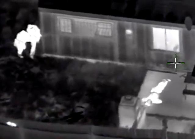Stephon Clark, 22, is visible on the ground after two police officers (L) shot him, in this still image captured from police aerial video footage released by Sacramento Police Department, California, U.S., on March 21, 2018. Courtesy Sacramento Police Department/Handout via REUTERS ATTENTION EDITORS - THIS IMAGE HAS BEEN SUPPLIED BY A THIRD PARTY. TPX IMAGES OF THE DAY