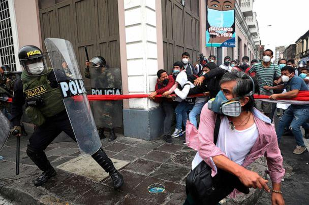 PHOTO: Police block supporters of former President Martin Vizcarra from reaching Congress while lawmakers swear-in Manuel Merino as the new president in Lima, Peru, Nov. 10, 2020. Vizcarra was ousted over his handling of the coronavirus pandemic. (Rodrigo Abd/AP)