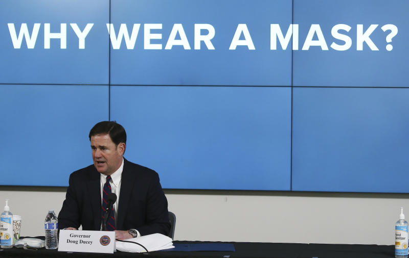 FILE - In this Thursday, July 9, 2020, file photo, Arizona Republican Gov. Doug Ducey speaks about the latest coronavirus update in Arizona and benefits of wearing a mask during a news conference in Phoenix. With the coronavirus spreading out of control and Arizona cities just beginning to require residents to wear masks in public last month, a few hundred people gathered in Scottsdale to make clear they did not approve of the heavy hand of government telling them to cover their faces. (AP Photo/Ross D. Franklin, Pool, File)