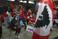 United Farm Workers gather during a Border Community Town Hall meeting at LUPE (La Union Del Pueblo Entero) where speakers slammed Texas governor Greg Abbott and former president Donald Trump border trip on Wednesday, June, 30, 2021 in San Juan, Texas. (Delcia Lopez/The Monitor via AP)