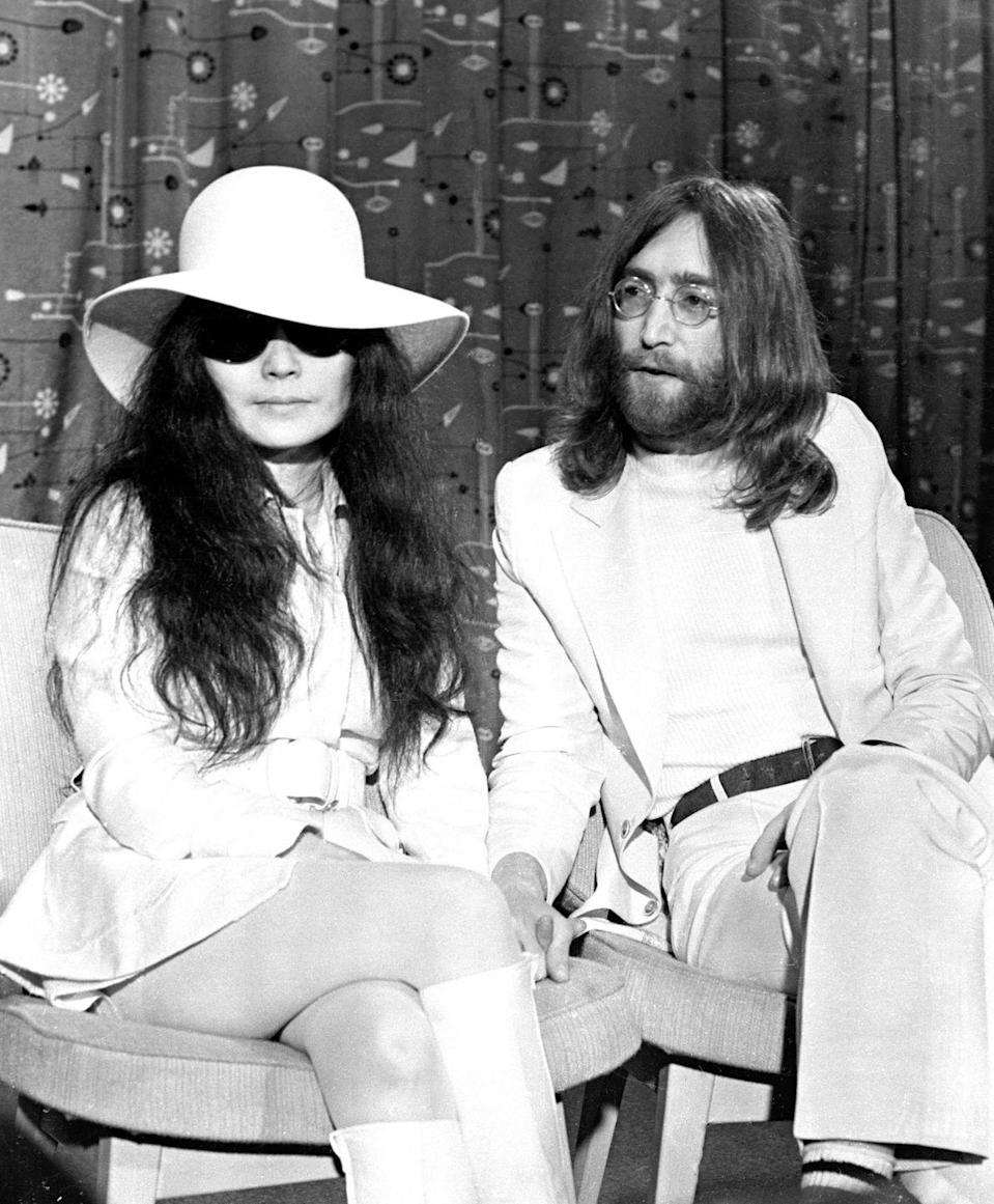"<p>John Lennon met Yoko Ono in 1966, when he was still married to his first wife Cynthia. After his divorce was finalized, Lennon and Ono married in 1969 in a <a href=""http://ultimateclassicrock.com/john-lennon-marries-yoko-ono/"" rel=""nofollow noopener"" target=""_blank"" data-ylk=""slk:10-minute ceremony"" class=""link rapid-noclick-resp"">10-minute ceremony</a> at the British Consulate office. They have one child together, Sean Lennon, and remained married until Lennon's death in 1973. </p>"