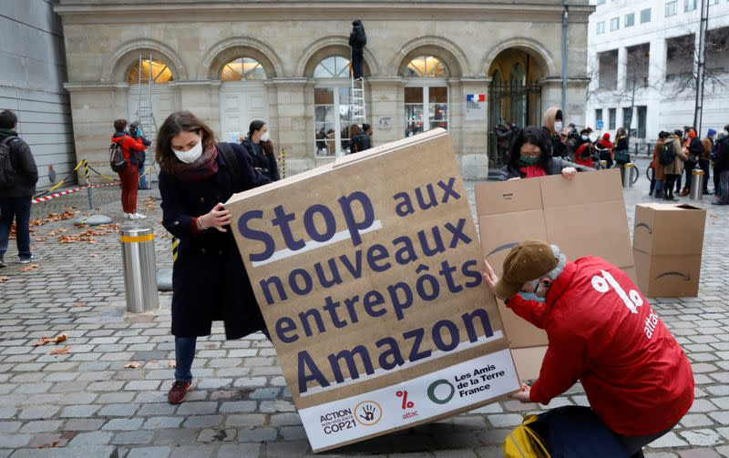 French activists demonstrate against Amazon in Paris