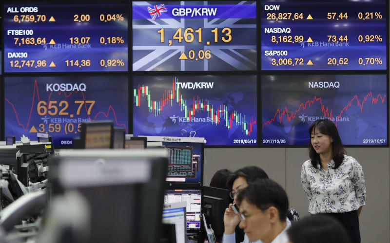Currency traders watch monitors at the foreign exchange dealing room of the KEB Hana Bank headquarters in Seoul, South Korea, Tuesday, Oct. 22, 2019. Shares are gaining in Asia after upbeat comments from President Donald Trump and other U.S. officials on the status of trade negotiations with China. (AP Photo/Ahn Young-joon)