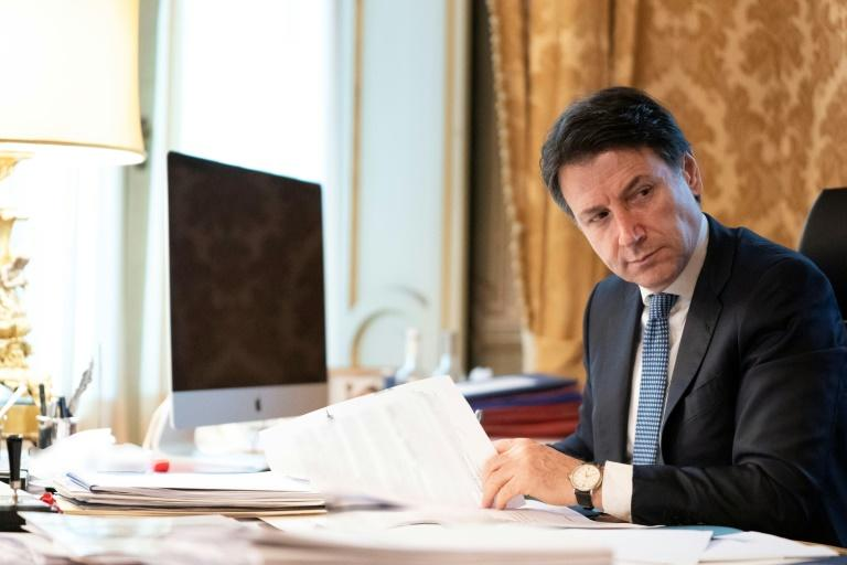 Prime Minister Giuseppe Conte has indicated that he would like to see most measures lifted by June (AFP Photo/Handout)