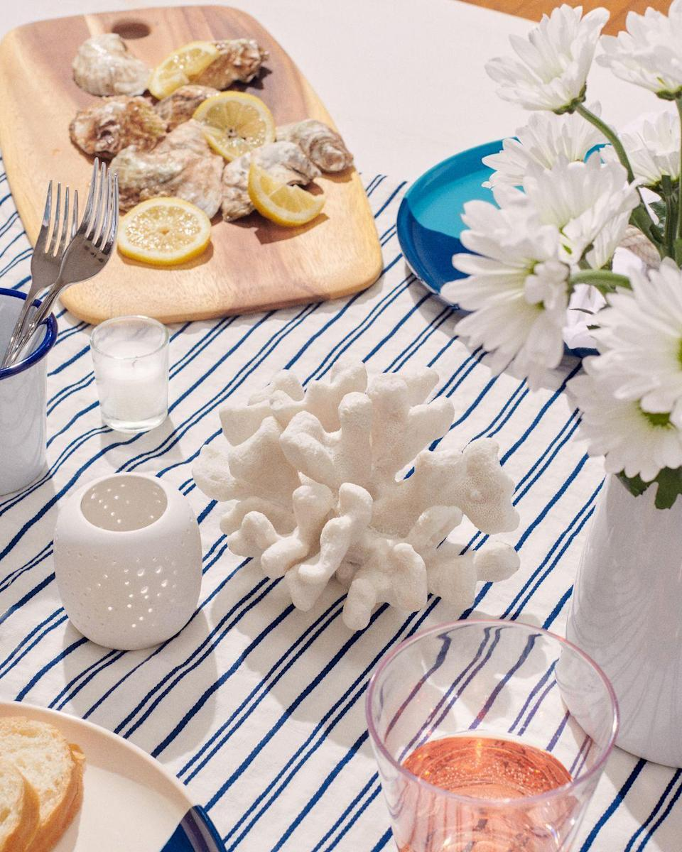 """<p><strong>Where do you source beautiful, festive decorations and tableware?</strong></p><p>I love to use <a href=""""https://social-studies.com/"""" rel=""""nofollow noopener"""" target=""""_blank"""" data-ylk=""""slk:Social Studies"""" class=""""link rapid-noclick-resp"""">Social Studies</a>—the founder, Amy Griffin, is a really good friend of mine. It's awesome for entertaining at home, even if it's just your family and you want the day to feel special. </p><p>They send a kit with everything you need to decorate a beautiful table—even flowers—with a guide on how to set it. Then you just rinse off the dishes, pack it up, and put it back in the mail. It's so easy, and it frees up your storage space. </p><p><strong>What advice would you give to someone who isn't usually the entertainer but is looking to do more hosting?</strong></p><p>I think it's important to keep things easy on yourself. I'm always talking about comfort food and eating what makes you feel good, but this summer, that's also extended to your safety and feeling like you're okay. </p>"""
