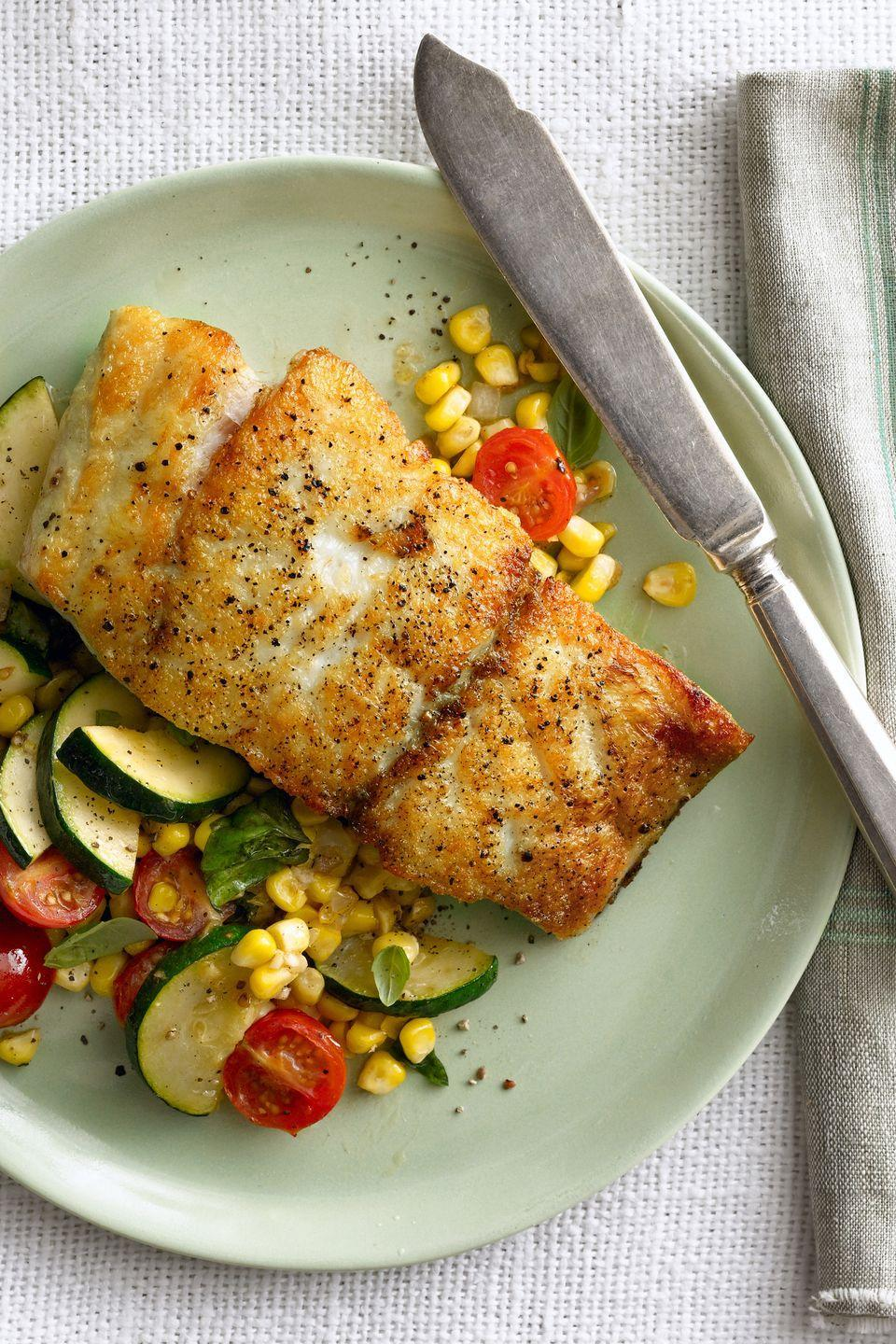 """<p>This refreshing seafood dinner is perfect for a late-summer or early-fall evening.<br></p><p><em><a href=""""https://www.goodhousekeeping.com/food-recipes/a16112/seared-grouper-corn-zucchini-tomato-saute-recipe-clx0914/"""" rel=""""nofollow noopener"""" target=""""_blank"""" data-ylk=""""slk:Get the recipe for Seared Grouper with Corn, Zucchini, and Tomato Sauté »"""" class=""""link rapid-noclick-resp"""">Get the recipe for Seared Grouper with Corn, Zucchini, and Tomato Sauté »</a></em> </p>"""