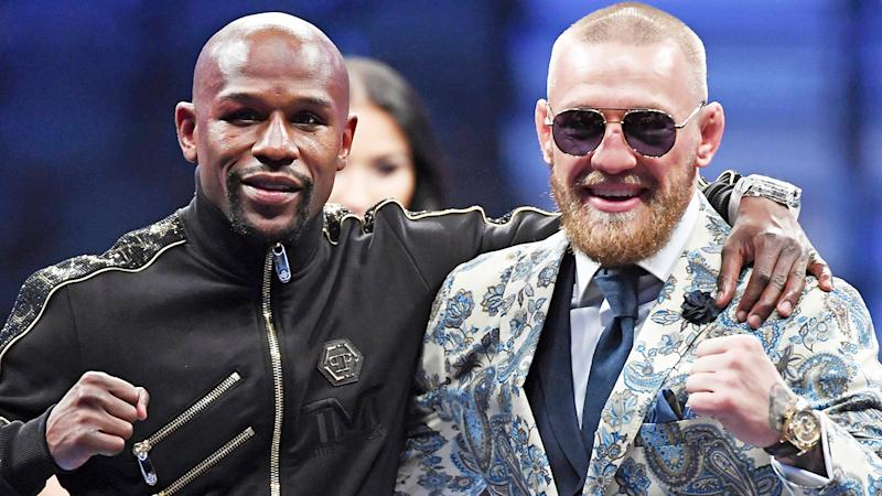 Floyd Mayweather Jr. is pictured alongside Conor McGregor prior to their 2017 boxing match.