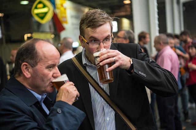 <p>Visitors drink pints of ale at the CAMRA (Campaign for Real Ale) Great British Beer festival at Olympia exhibition center on August 8, 2017 in London, England. (Photo: Carl Court/Getty Images) </p>