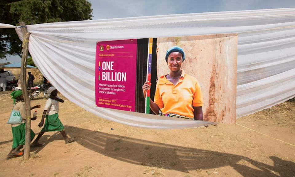 A banner in Nigeria with a picture of a young woman smiling