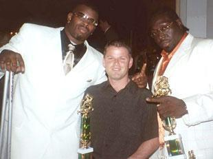 This photo was taken at Miami's team awards banquet following the 2002 season. From left to right are Cornelius Green, Nevin Shapiro and Andrew Williams.