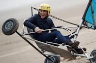 """<p>The Duke and Duchess of Cambridge went """"land yachting"""" on <a href=""""https://www.townandcountrymag.com/society/tradition/g36519274/prince-william-kate-middleton-scotland-trip-2021-photos/"""" rel=""""nofollow noopener"""" target=""""_blank"""" data-ylk=""""slk:the beaches of St Andrews, Scotland"""" class=""""link rapid-noclick-resp"""">the beaches of St Andrews, Scotland</a>. The pair got a bit competitive, racing each other on the sand. Kate even appeared to get a bit stuck (as seen here) and required some assistance—she seemed unfazed, however, laughing and smiling the whole time. </p>"""