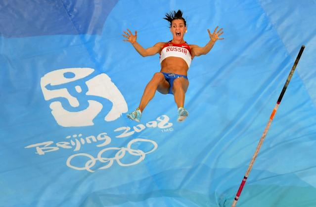 BEIJING - AUGUST 18: Elena Isinbaeva of Russia celebrates successfully jumping a new World Record of 5.05 in the Women's Pole Vault Final at the National Stadium on Day 10 of the Beijing 2008 Olympic Games on August 18, 2008 in Beijing, China. (Photo by Harry How/Getty Images)