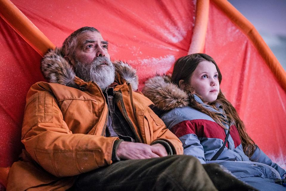 """George Clooney (with Caoilinn Springall) directs and stars as an Arctic scientist trying to keep astronauts from returning to a global catastrophe in """"The Midnight Sky."""""""