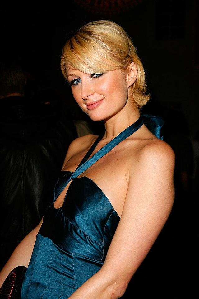"""A sweet and demure Paris Hilton smiles for the cameras at the Victoria's Secret Phi Beta PINK party in Beverly Hills. Jeff Vespa/<a href=""""http://www.wireimage.com"""" target=""""new"""">WireImage.com</a> - October 18, 2007"""