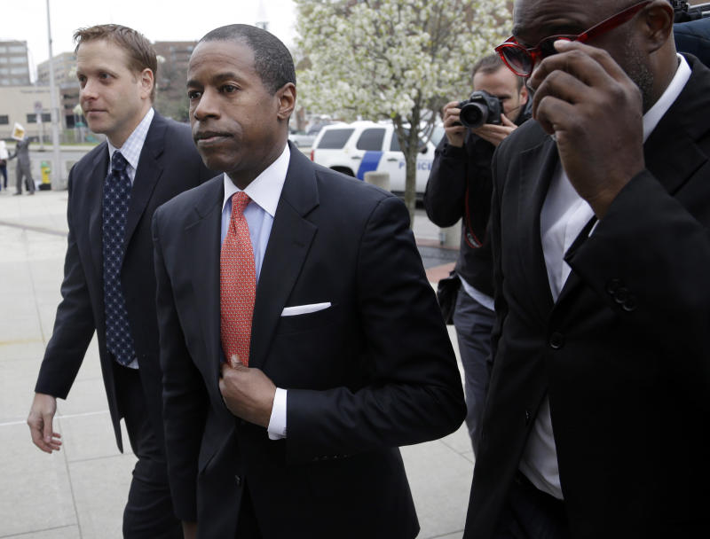 CORRECTS LOCATION TO WHITE PLAINS, NOT WESTCHESTER - New York State Sen. Malcolm Smith, second form left, arrives to federal court in Westchester, N.Y., Tuesday, April 23, 2013.  Six politicians are up for arraignment in a case that alleges an audacious plot to buy a line on New York City's mayoral ballot. Defense lawyers said Monday that not-guilty pleas are expected from all six defendants, including Smith, at Tuesday's arraignment. He is accused of scheming with New York City Councilman Daniel Halloran, a Republican, to bribe county Republican leaders for the GOP line on this year's mayoral ballot. (AP Photo/Seth Wenig)