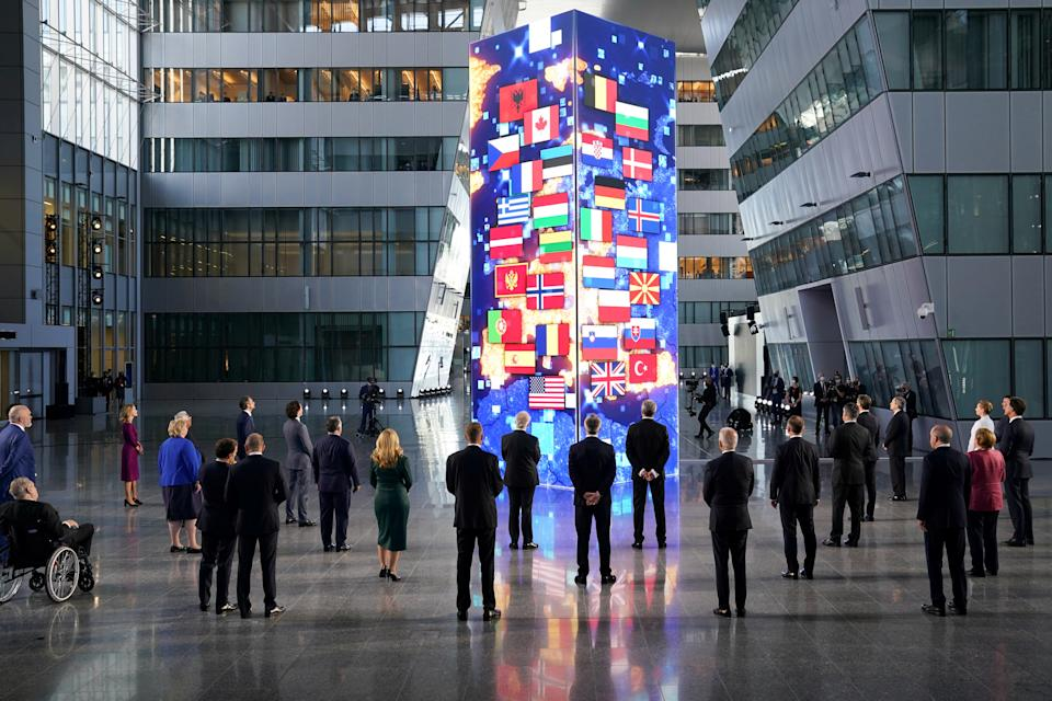 NATO heads of the states and governments look at a digital installation after posing for a family photo, during the NATO summit at the Alliance's headquarters in Brussels, Belgium June 14, 2021. REUTERS/Kevin Lamarque/Pool
