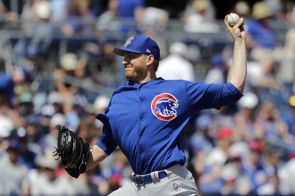 Chicago Cubs starting pitcher Mike Montgomery throws against the San Diego Padres in the first inning of a spring training baseball game Sunday, March 24, 2019, in Peoria, Ariz. (AP Photo/Elaine Thompson)