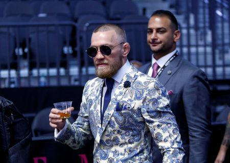 FILE PHOTO: UFC lightweight champion Conor McGregor of Ireland arrives for a post-fight news conference at T-Mobile Arena in Las Vegas, Nevada, U.S. August 26, 2017. REUTERS/Steve Marcus