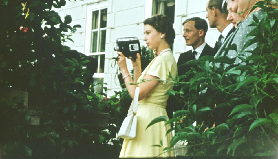 A young Queen films with a Cine camera  at a private house, as a guest of the Governor General of New Zealand, Sir Willoughby Norrie (not shown) on Christmas Day, 1953. (Factual Fiction)