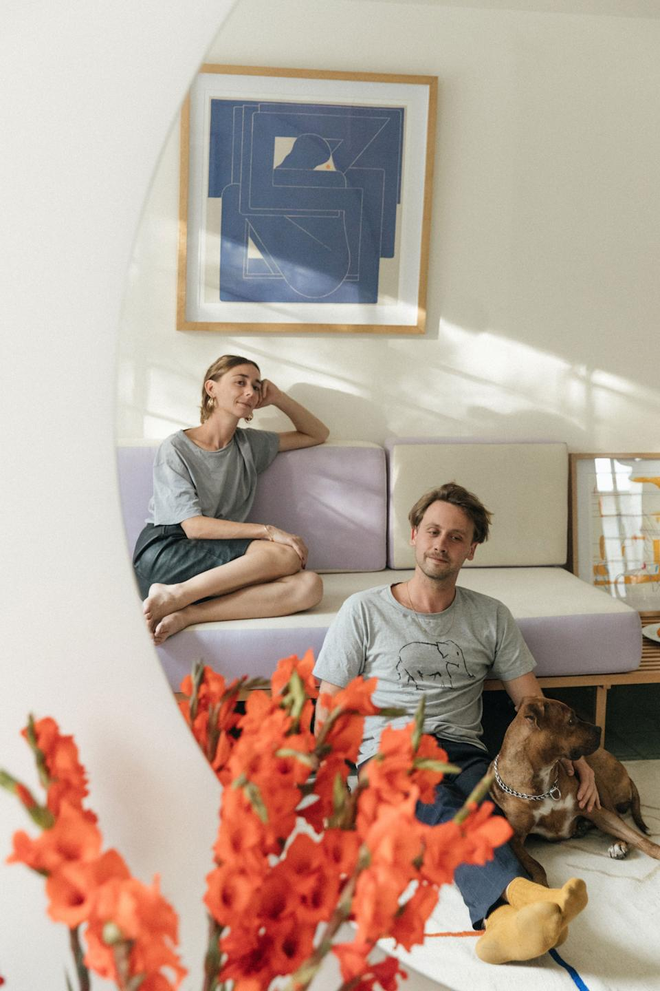 """<div class=""""caption""""> Aude Jan, Charles Gout, and their dog. </div>"""