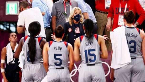 PHOTO: First Lady Jill Biden talks with players from the U.S. basketball team during the Olympic Games in Tokyo, July 24, 2021. (Andrew Boyers/Reuters)