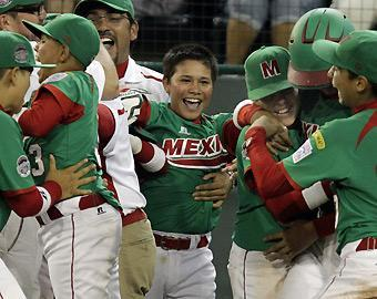 Players and coaches from Mexico celebrate a 3-2 victory over Japan during international pool play on Aug. 21