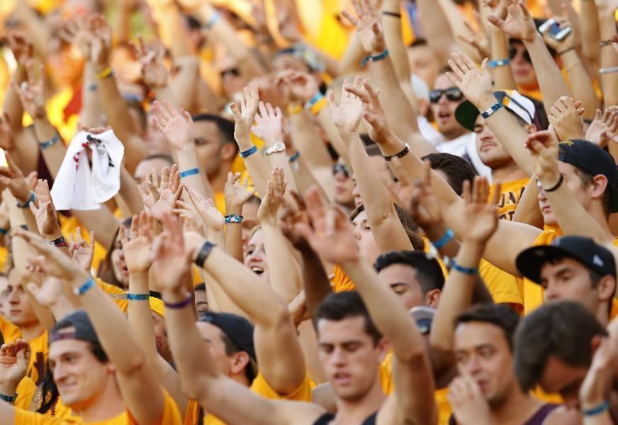 Arizona State fans cheer after a touchdown against Washington during the second half of an NCAA college football game, Saturday, Oct. 19, 2013, in Tempe, Ariz. Arizona State won 53-24. (AP Photo/Matt York)