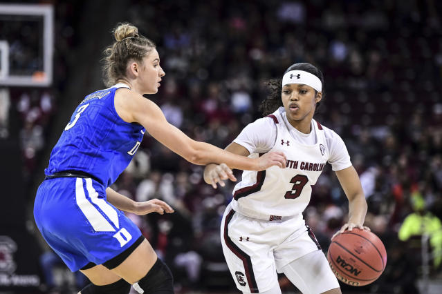 South Carolina guard Destanni Henderson, right, is defended by Duke guard Miela Goodchild during the first half of an NCAA college basketball game Thursday, Dec. 19, 2019, in Columbia, S.C. (AP Photo/Sean Rayford)