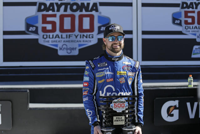 Ricky Stenhouse Jr. holds his trophy after winning the pole position for the Daytona 500 during NASCAR auto race qualifying at Daytona International Speedway, Sunday, Feb. 9, 2020, in Daytona Beach, Fla. (AP Photo/Terry Renna)