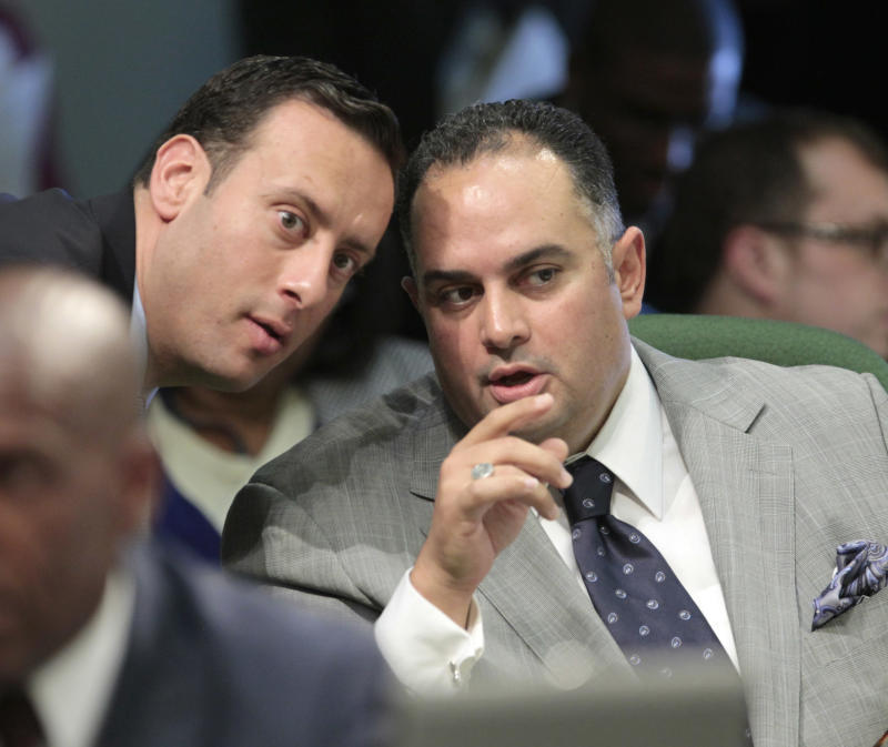 Assembly Speaker John Perez, D-Los Angeles, right, confers with Assemblyman Roger Hernandez, D-West Covina, as the Assembly debated Perez's measure to close a corporate tax loophole and used the money for college scholarships, at the Capitol in Sacramento, Calif., Monday, Aug. 13, 2012.  The measure, AB1500, eliminates a $1 billion tax break for out-of-state corporations and uses the money for college scholarships for families earning between $80,000-$100,000, was approved 54-25 and sent to the Senate. (AP Photo/Rich Pedroncelli)