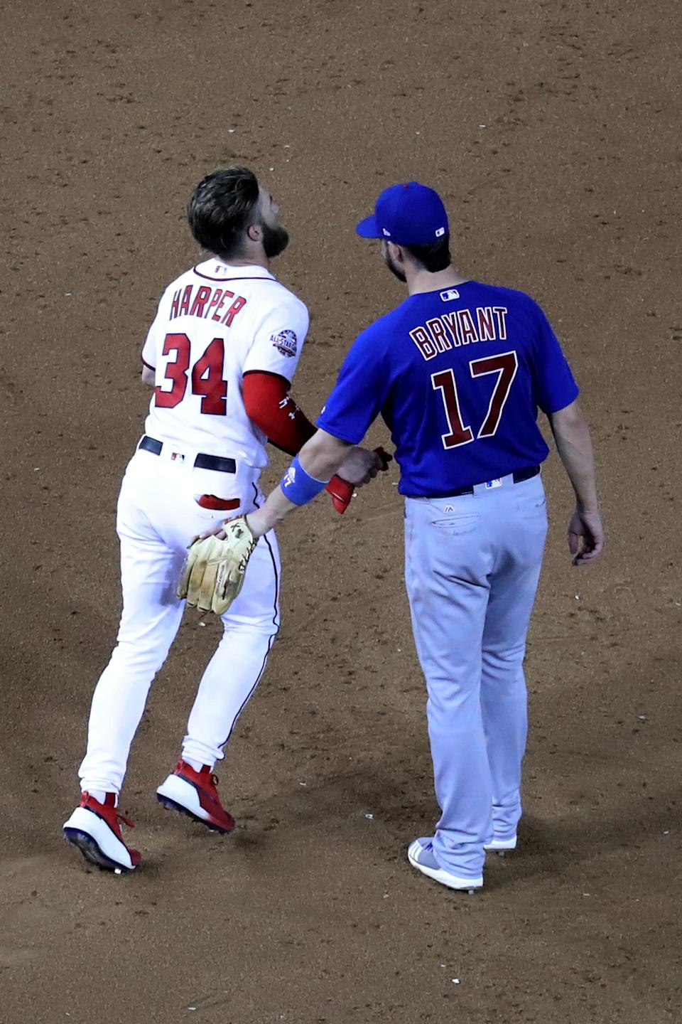 WASHINGTON, DC – SEPTEMBER 6: Bryce Harper #34 of the Washington Nationals talks with Kris Bryant #17 of the Chicago Cubs at Nationals Park on September 6, 2018 in Washington, DC. (Photo by Rob Carr/Getty Images)