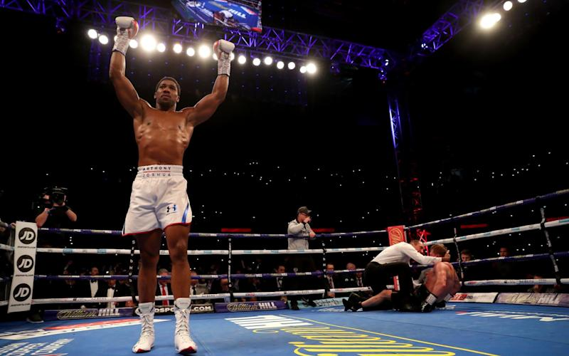 Anthony Joshua celebrates making it 22 wins unbeaten - Getty Images Europe
