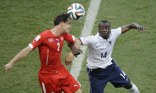Switzerland's Stephan Lichtsteiner, left, and France's Blaise Matuidi go for a header during the group E World Cup soccer match between Switzerland and France at the Arena Fonte Nova in Salvador, Brazil, Friday, June 20, 2014. (AP Photo/Sergei Grits)
