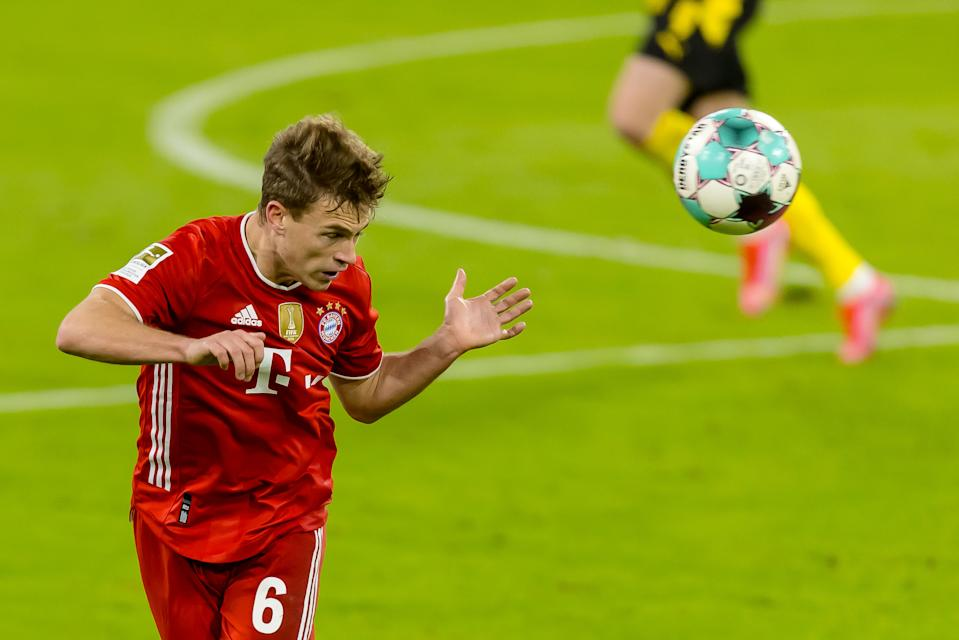 MUNICH, GERMANY - MARCH 06: (BILD ZEITUNG OUT) Joshua Kimmich of Bayern Muenchen controls the ball during the Bundesliga match between FC Bayern Muenchen and Borussia Dortmund at Allianz Arena on March 6, 2021 in Munich, Germany. (Photo by Roland Krivec/DeFodi Images via Getty Images)