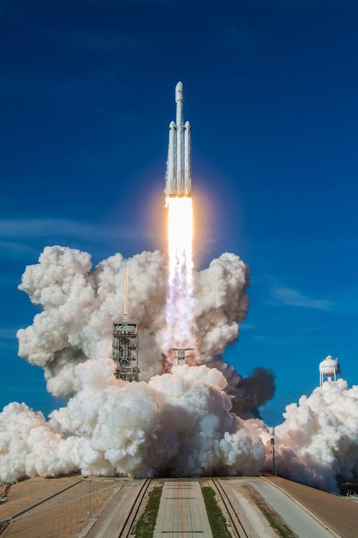 SpaceX's Falcon Heavy rocket lifts off its launchpad for the first time on February 6, 2018.