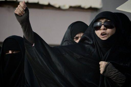 A Bahraini Shiite Muslim woman protests during the funeral of Ahmad Ismail Hassan on Friday. A 15-year-old youth was shot by anti-riot police while attending the funeral of the citizen journalist, killed during a protest in the Gulf kingdom late last month, the opposition says