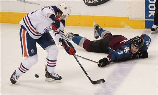 Colorado Avalanche's Shane O'Brien (5) breaks up a pass as Edmonton Oilers' Ales Hemsky (83) passes during the first period of an NHL hockey game on Tuesday, March 12, 2013 in Denver. (AP Photo/Barry Gutierrez)