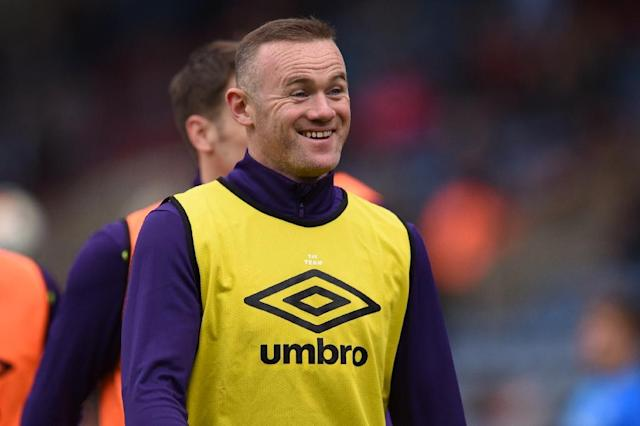 Wayne Rooney, former England captain and Manchester United star, is expected in the US capital to tie up the details of a two-and-a-half-year contract with D.C. United, which reports have said will be worth $13 million (AFP Photo/Oli SCARFF)