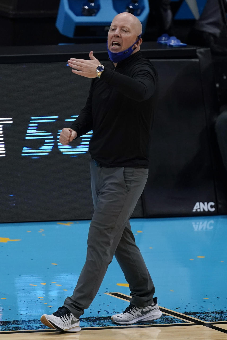 UCLA head coach Mick Cronin directs his team during the first half of a men's Final Four NCAA college basketball tournament semifinal game against Gonzaga, Saturday, April 3, 2021, at Lucas Oil Stadium in Indianapolis. (AP Photo/Michael Conroy)