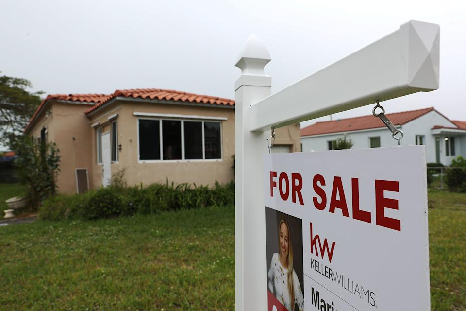 MIAMI, FLORIDA - JANUARY 30: A For Sale sign is seen outside of a home on January 30, 2019 in Miami, Florida. The pending home sales index dropped 2.2 percent to 99.0, down from 101.2 in November, the weakest reading since April 2014 according to the National Association of Realtors. (Photo by Joe Raedle/Getty Images)