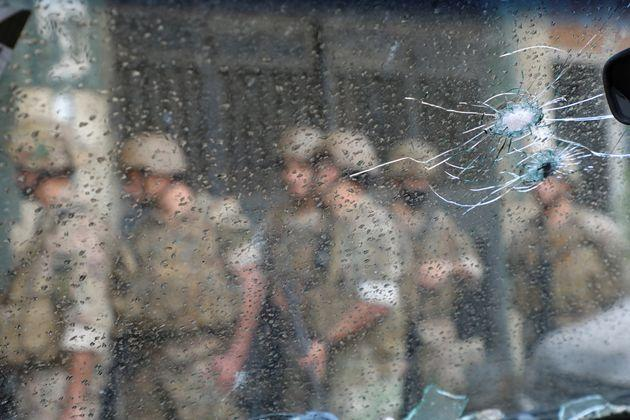 Army soldiers are seen behind a glass with gun holes, after gunfire erupted in Beirut, Lebanon October 14, 2021.  REUTERS/Mohamed Azakir (Photo: Mohamed Azakir via Reuters)
