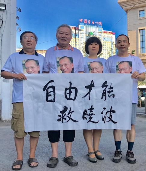 Ding Jiaxi (right) with other activists in an undated picture. Photo: Handout